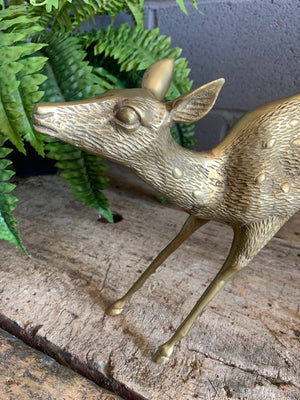 A large brass Mid-Century Hollywood Regency fawn statue