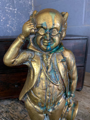 A large brass Mr Pickwick doorstop