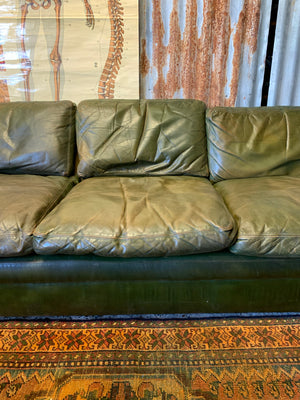 A large 3 seater Modernist Italian sofa in green leather of boat or 'egg' form