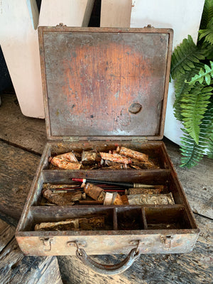 A wooden artist's box with palettes, brushes and paints by C. Roberson