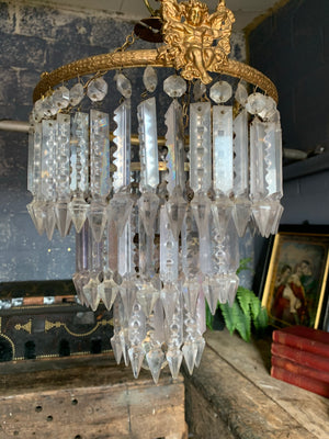 A gilt three tier crystal lustre chandelier - large