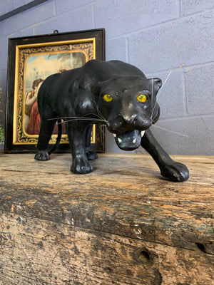 A very large mid century black leather panther (83cm)