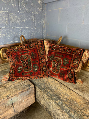 A large red ground Persian carpet cushion - 50cm