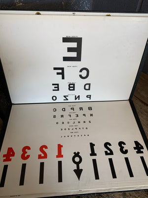 An optometrist trial lens set, charts and tests