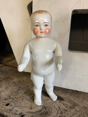 A 19th Century porcelain frozen Charlie doll