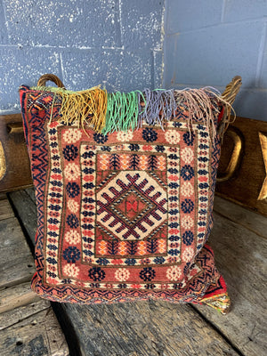 A large red ground Persian carpet cushion - 48cm
