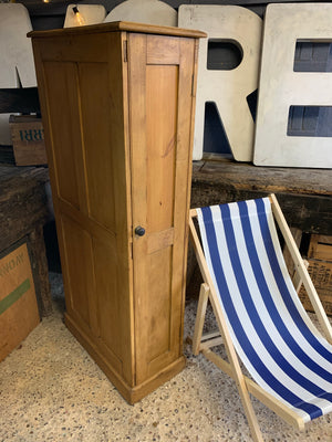 A tall and slim Victorian pine cupboard