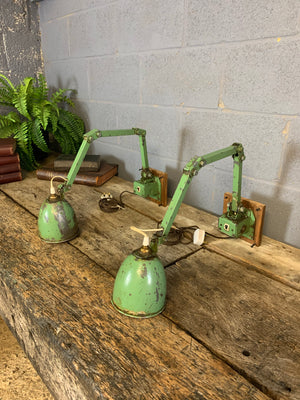 A pair of vintage industrial Memlite anglepoise lamps