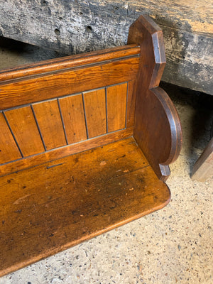 A small wooden 19th century church pew