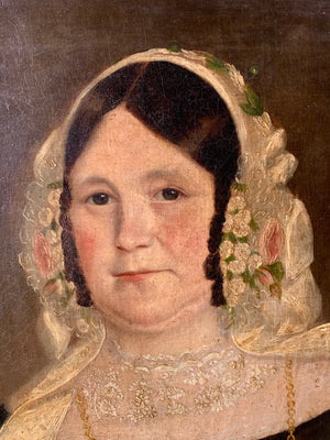 A large 19th century oil on canvas portrait of a lady