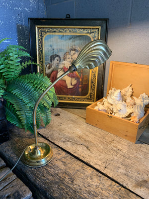 A brass Art Deco goose neck desk lamp