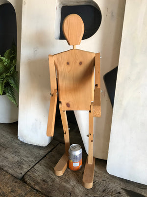 A wooden folk art lay figure