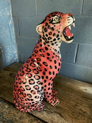 A large pink ceramic leopard statue made in Italy
