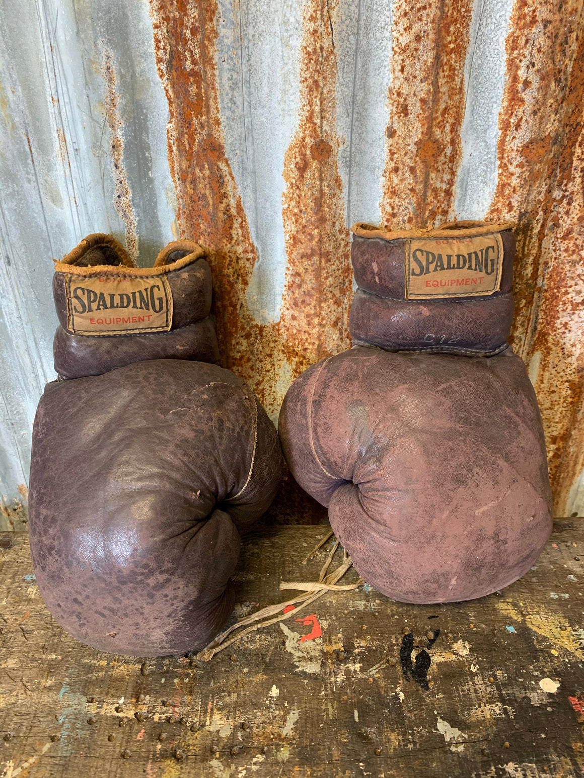 A vintage pair of brown leather Spalding boxing gloves