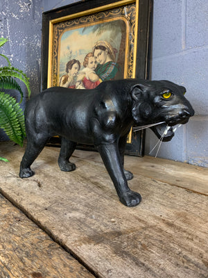 A large mid century black leather panther (56cm)