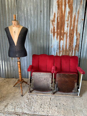 A pair of Art Deco red velvet flip cinema or theatre seats