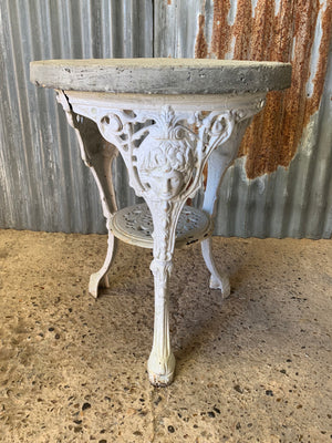 A white cast iron Britannia garden table with cast stone top