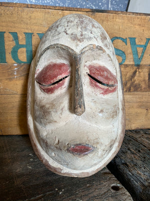 An African Galoa hand-carved wooden mask from Gabon
