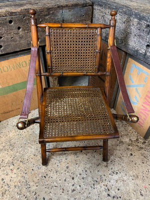 A faux bamboo carved hardwood folding campaign chair