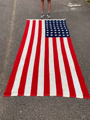 A very large US flag with Philadelphia Quartermaster maker's mark