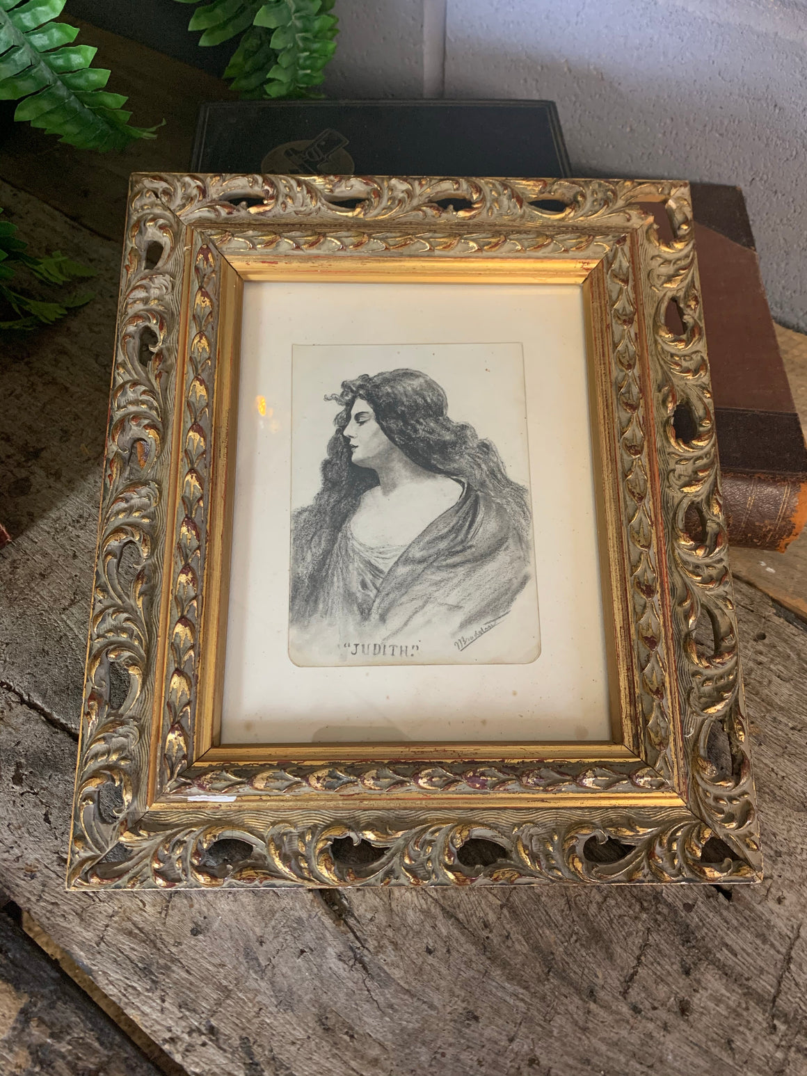 An Art Nouveau framed and signed pencil portrait of a woman