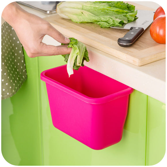 Plastic basket that you can hang on a door / cabinet to use as a storage or as a trash can