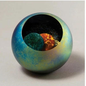Glass Eye Studio Paperweight that is multicolored and clear