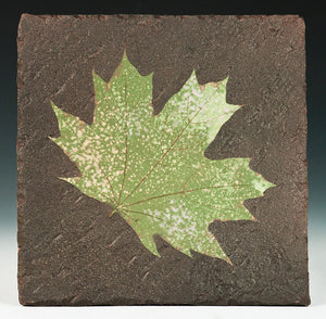 Black Tile with Maple Leaf
