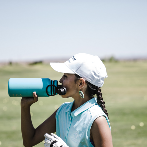 Golf Lady Drinking Water