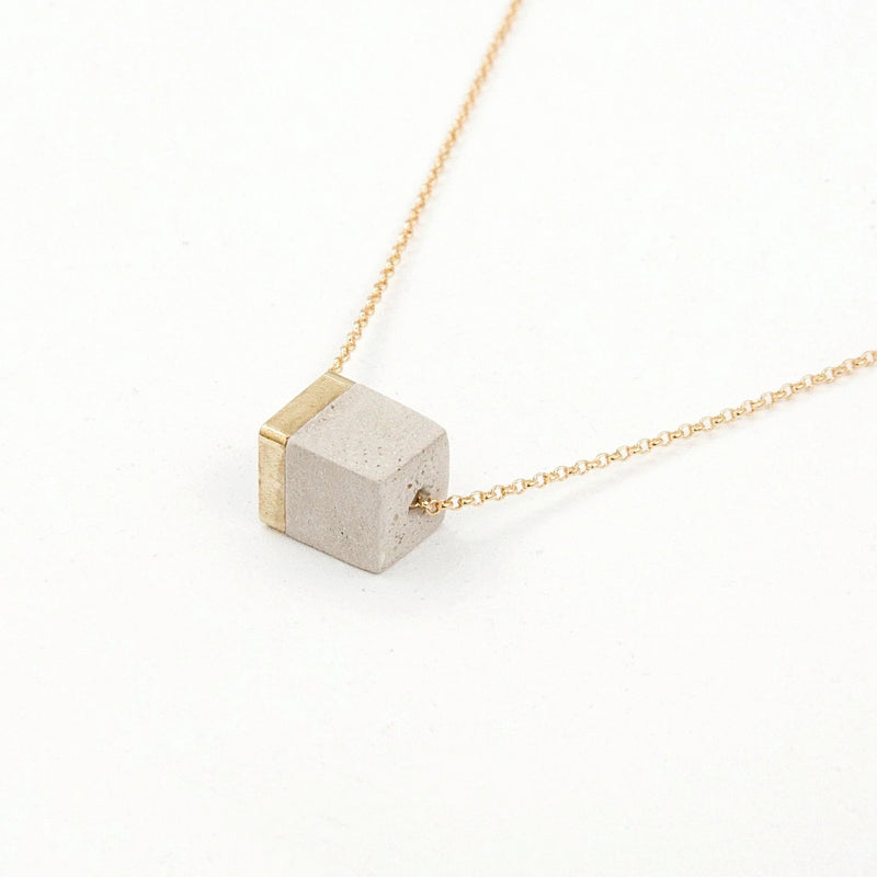 small block with brass cube