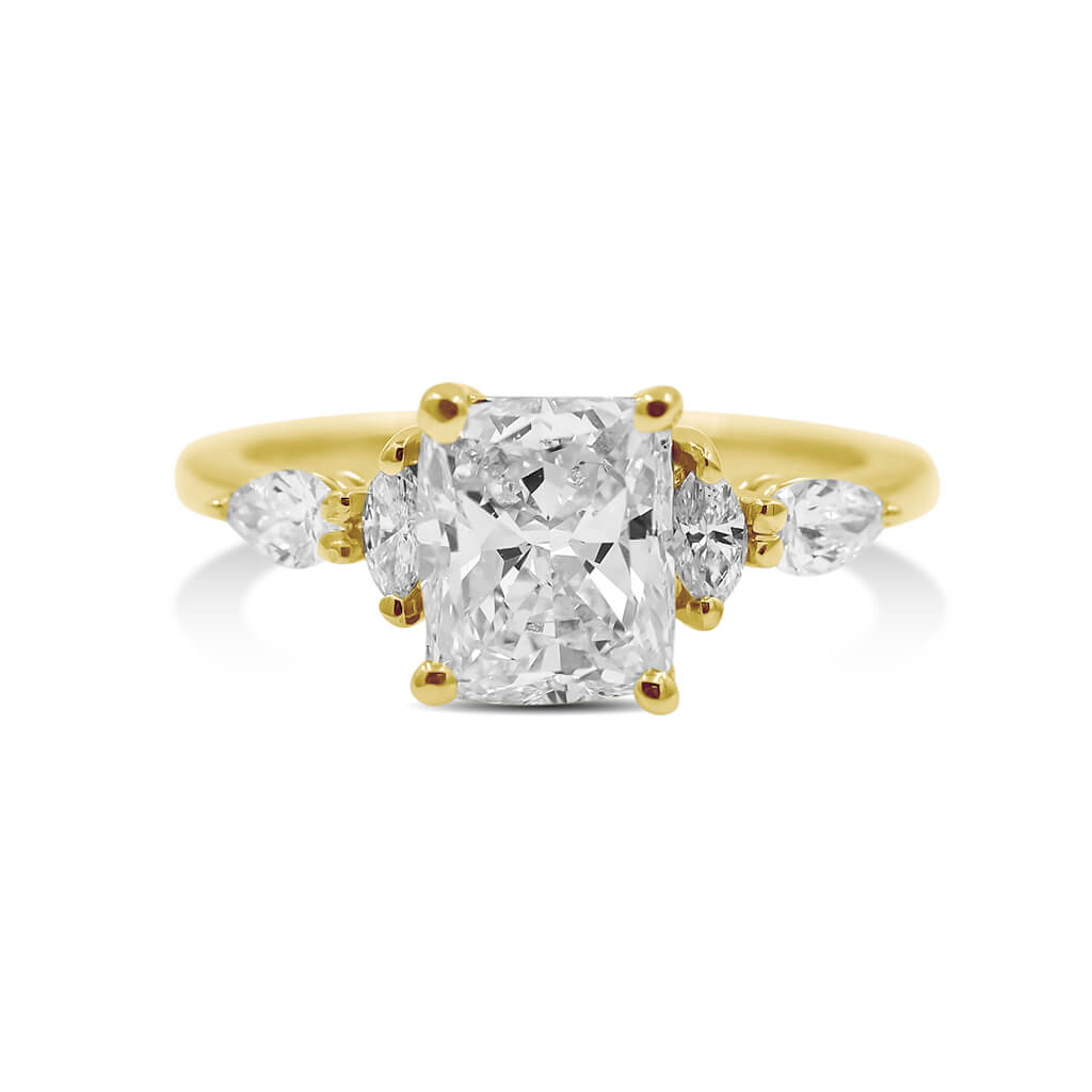 cushion diamond engagement ring in 14k yellow gold