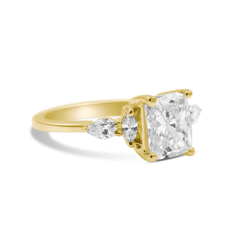 cushion diamond engagement ring in 14k yellow gold side view