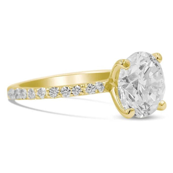 round diamond engagement ring in 14k yellow gold side view