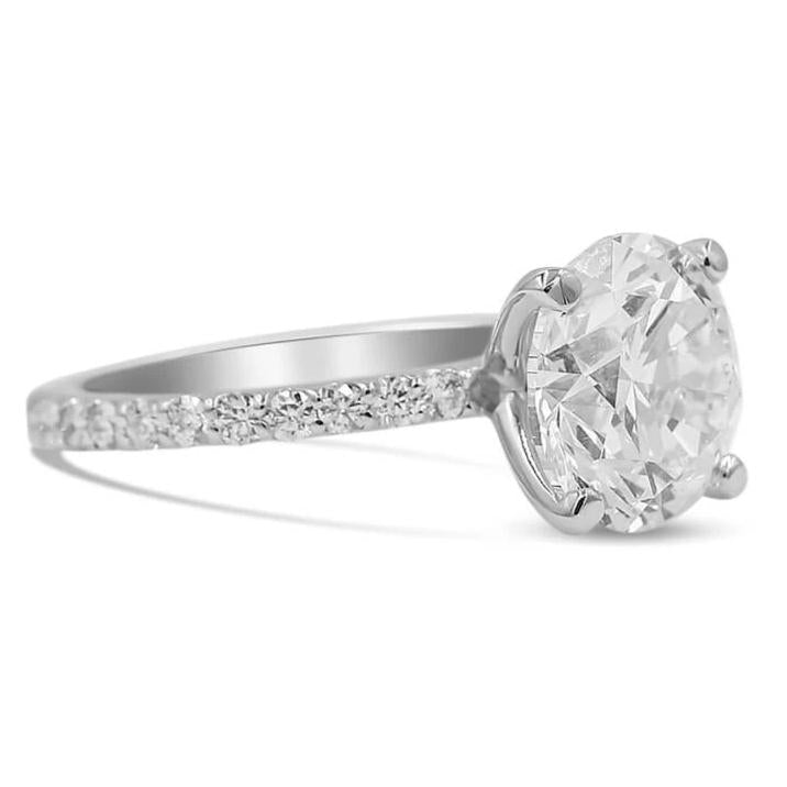 round diamond engagement ring in 14k white gold side view