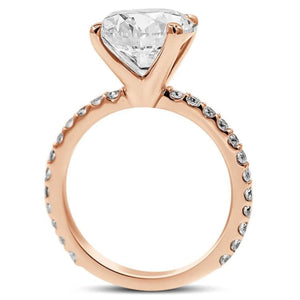 round diamond engagement ring in 14k rose gold side view