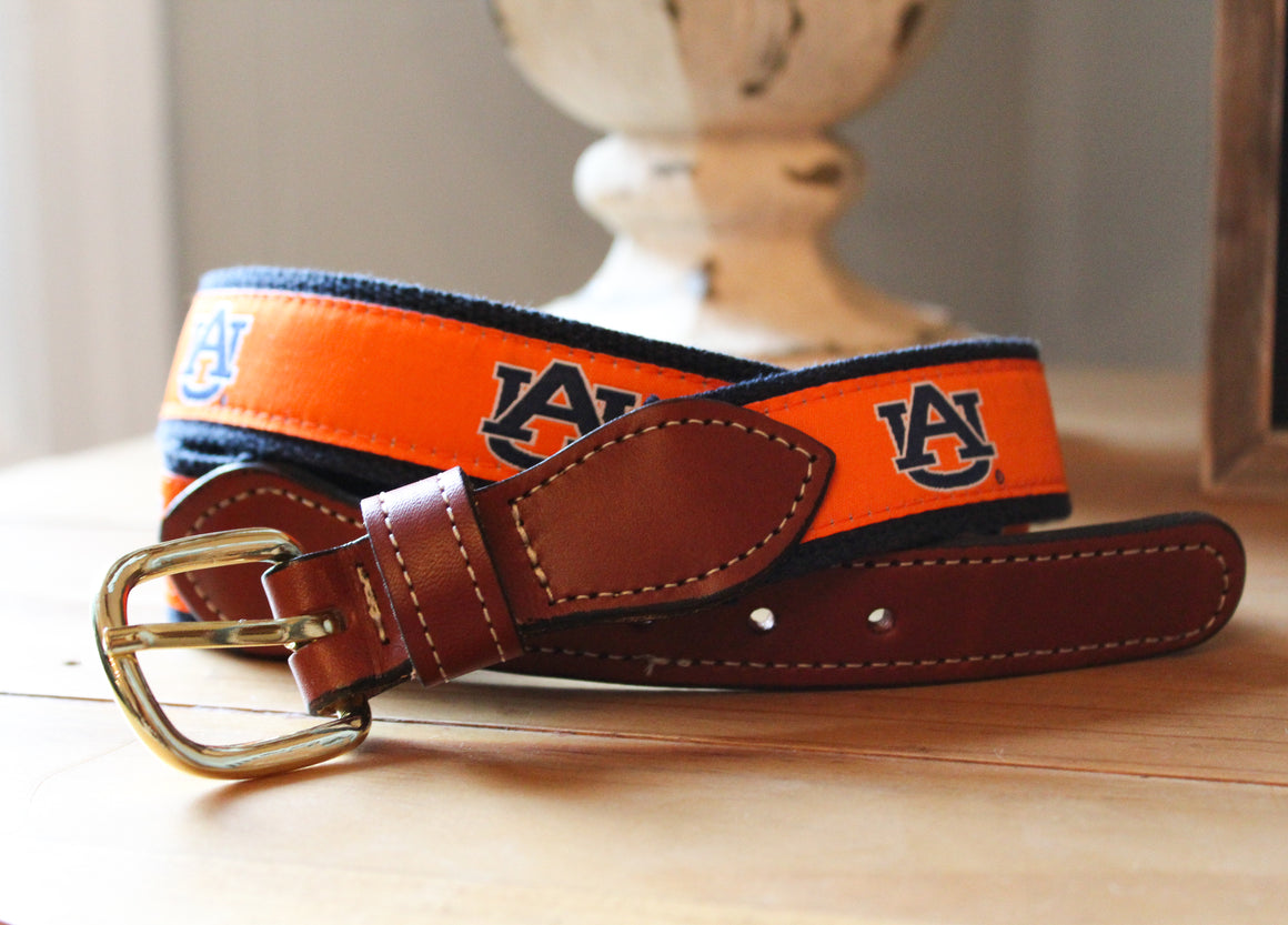 UGA Web Ribbon Belt with leather buckle. Red with black logo