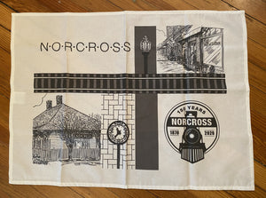 Historic Norcross 150th Tea Towel in black and white. Features Norcross Station, a street scape, clock and the 150th logo. License plate - silver with black logo