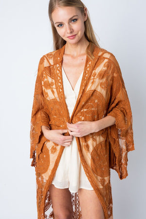 This beautiful long lace kimono is the perfect piece to throw on over jeans and a shirt or over your favorite dress.