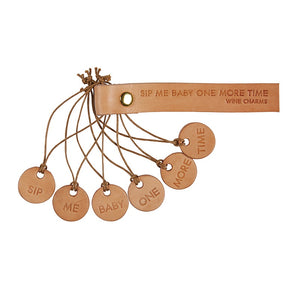 "Leather Wine Charms come with an assortment of phrases on genuine leather circles. Circles measure approximately 1"". Set includes:  Sip Me Baby One More Time"