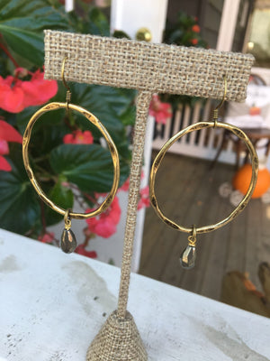 Locally made, these gorgeous pressed hoop earrings which accent beads are the perfect statement piece.