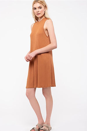 An adorable shift dress with a leopard print tie back. It is soft and light-weight making for the perfect summer dress.