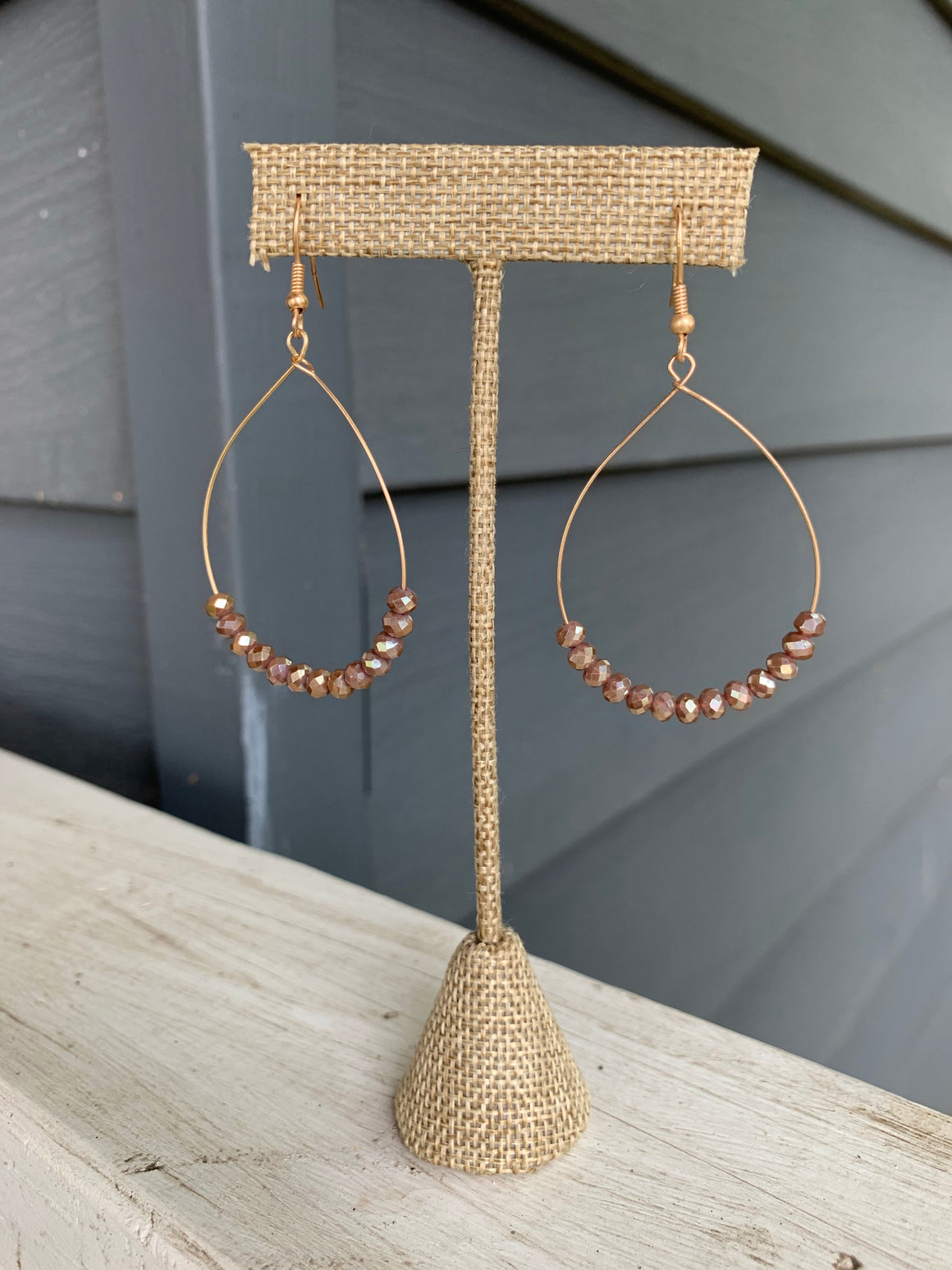 Glass beaded earrings on gold wire with ear hook.