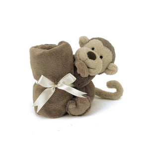 A sweet, cuddly monkey snuggles one corner of a plush, wonderfully soft blanket baby will love to cozy up with.
