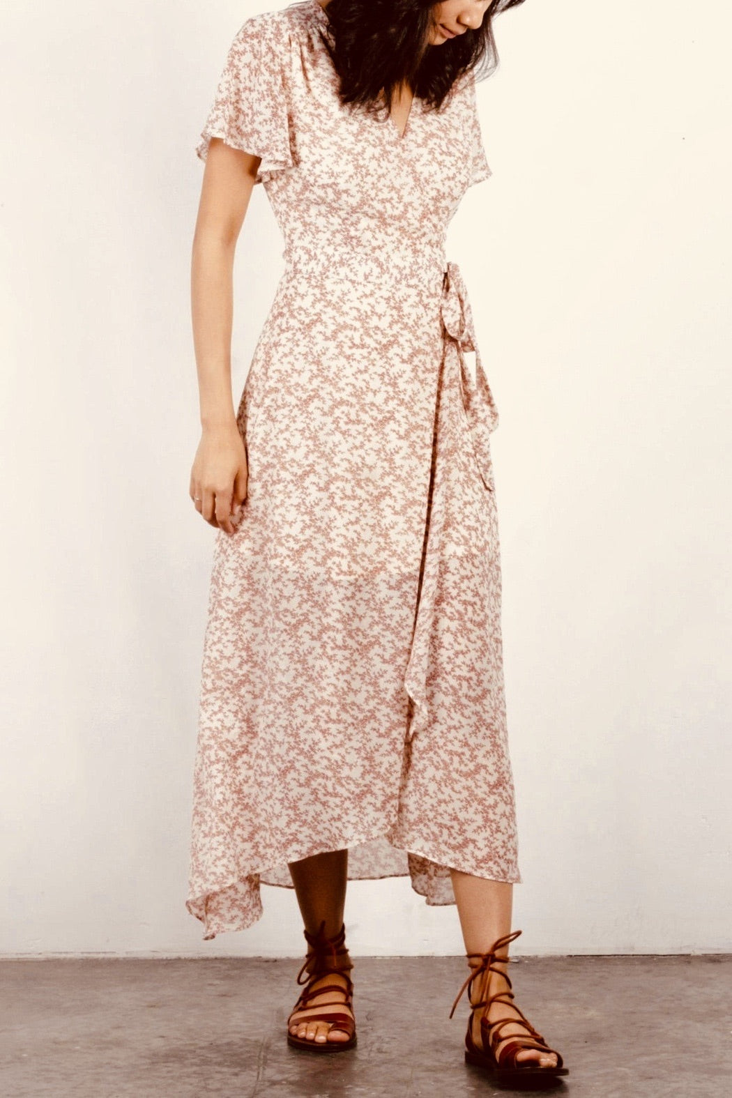 Floral maxi dress in a gorgeous wrap silhouette featuring flirty short sleeves.  Fiber Content: 100% Polyester