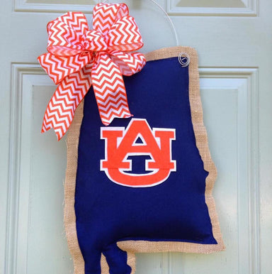 State of Alabama, Auburn themed door hanger. Navy blue with orange auburn logo and orange and white bow.
