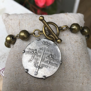 Bracelet with face coin