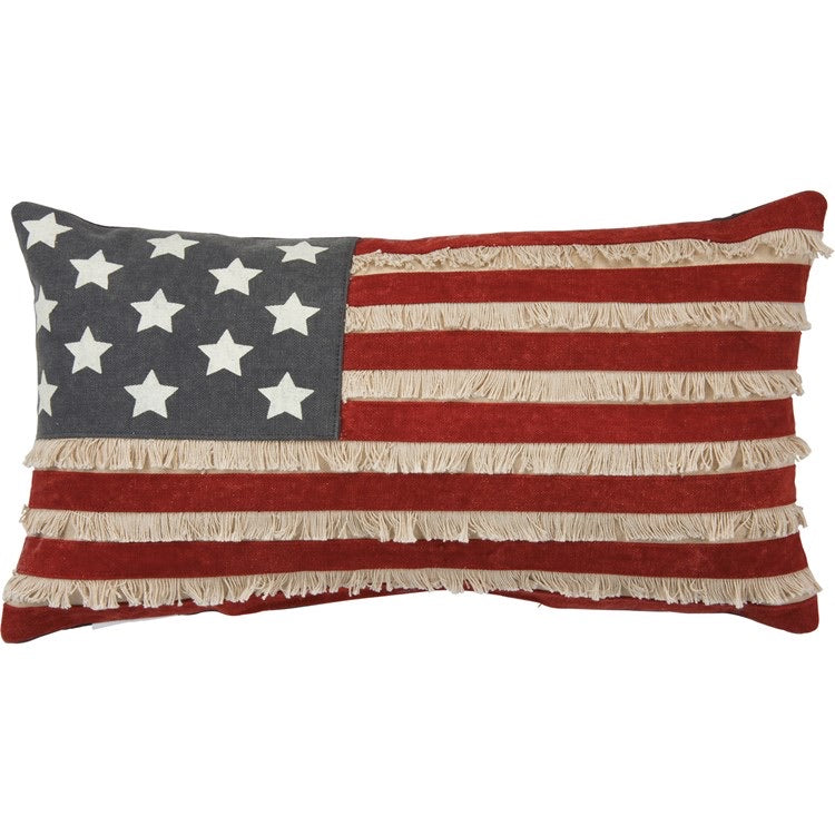 "A unconventional take on the American flag, this distressed canvas pillow features a tan, cream, and navy palette with block print star designs, canvas stripes, and fringe details throughout. Complements well with other pieces in collection. Measures 19""x10"". Made of cotton canvas and has a hidden zipper."