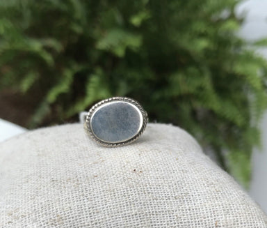 Oval Sterling silver ring with a small rope border.