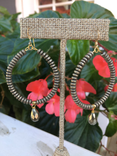 Beaded hoop earrings with tear drip accent beads. Locally made