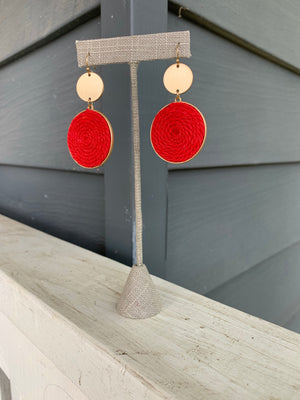 Gold and red thread disk earrings set in gold with ear hook.